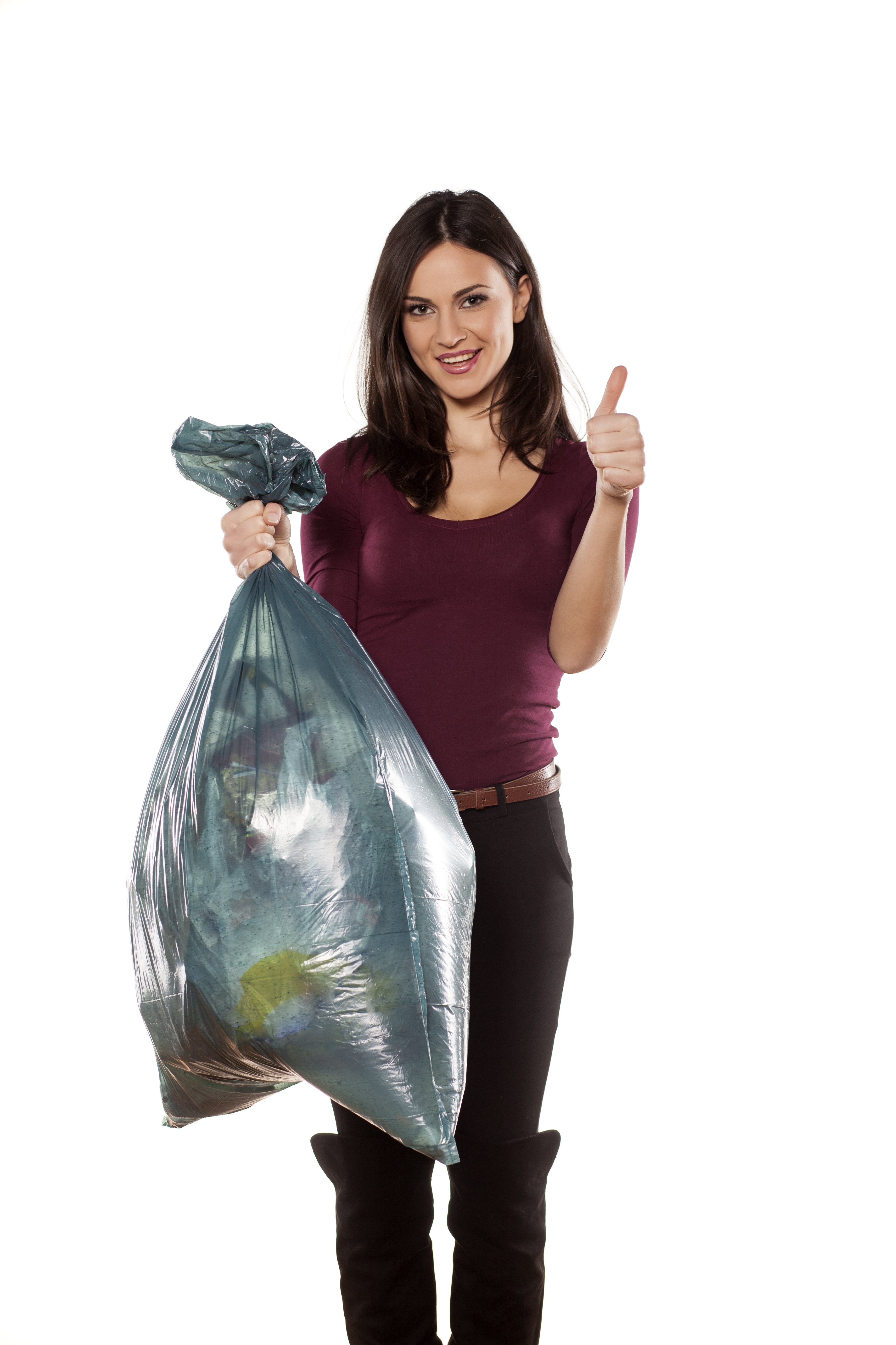 happy young woman holding garbage bag and showing thumbs up
