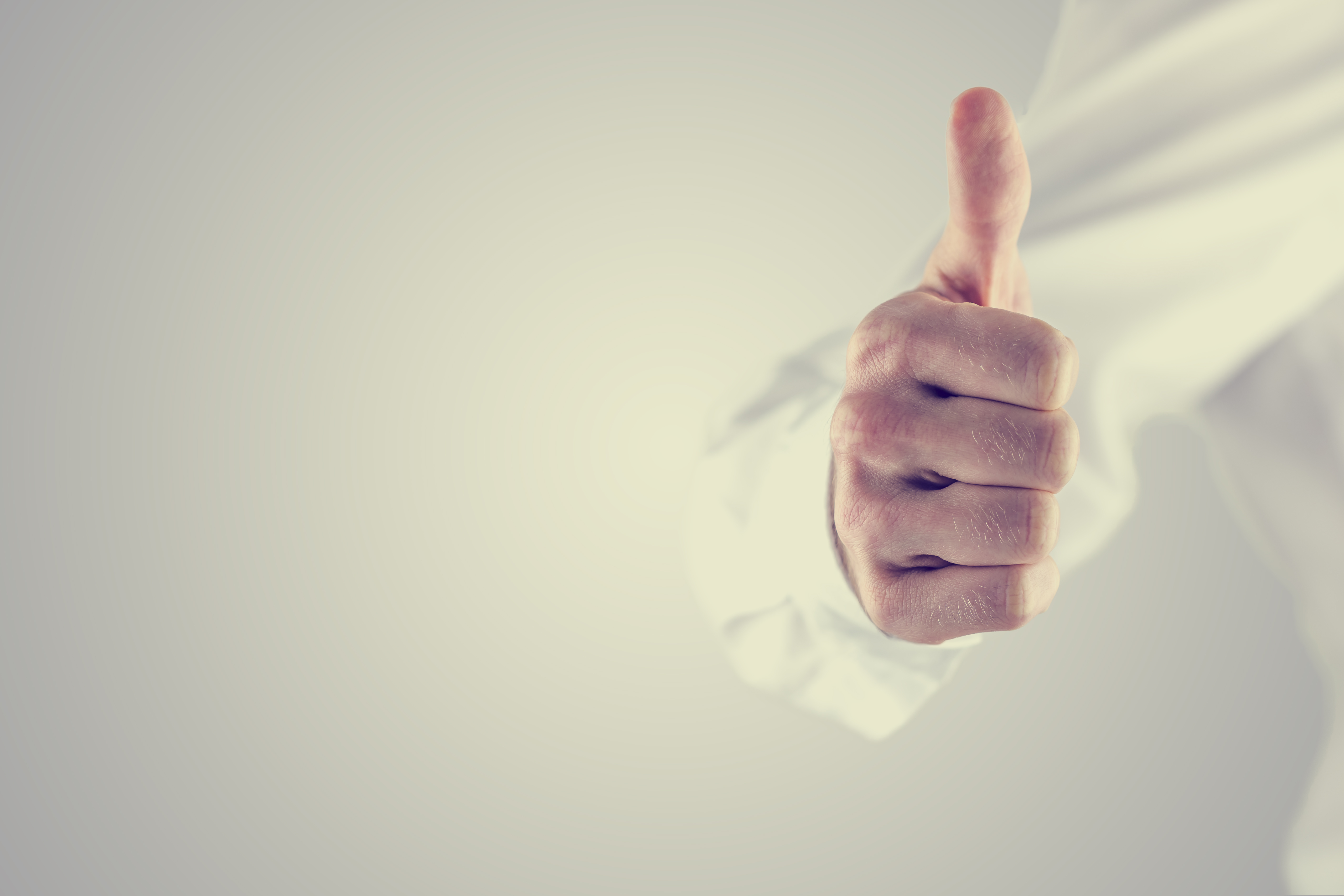 Retro style image of a man giving a thumbs up